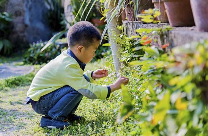 Little boy playing in the garden at London Nursery